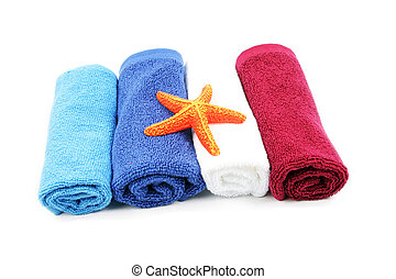 Colorful towels and orange starfish isolated on a white...