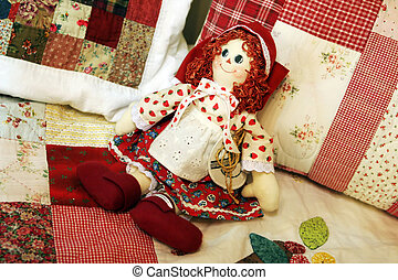 Patchwork doll - Pretty patchwork quilt doll on a bed