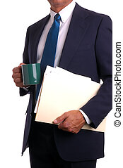 Businessman in suit holding file and coffee