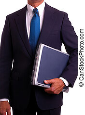 Businessman in suit holding laptop computer