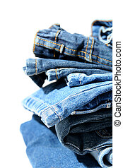 Blue jeans - Pile of trousers made of blue denim jeans