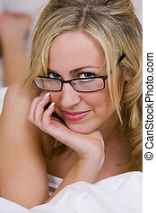 Intelligent Beauty - A beautiful young blond woman looking...