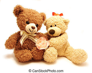couple of teddy-bears sitting together holding the rose...
