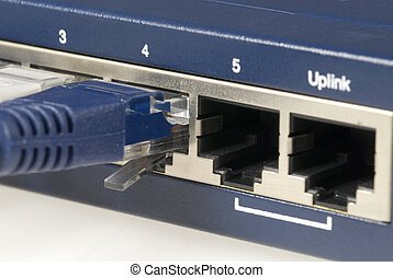Ethernet Cable and Router - Close up detail of the basic...