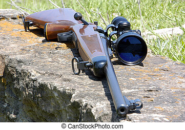 Rifle with Scope - A high powered rifle with a scope mounted...
