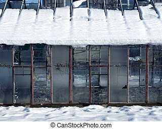 Winter greenhouse - Old glasshouse with a snow on roof top