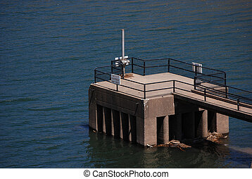 Reservoir outflow tower - reservoir dam water outflow tower...
