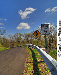 Dangerous Road - Photo of a speed limit sign and curvy road...