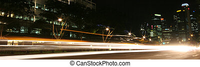 Cars by night - Cars racing by in Singapore