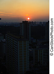 Sunset skyline - A sunset skyline with a big sun in...