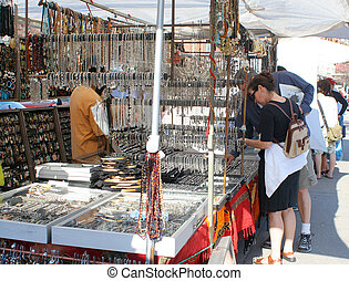 street vendors - people shopping for jewelry from street...