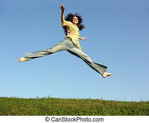 jump girl with hair on sky