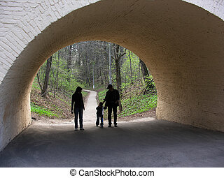 family in arch from spring wood