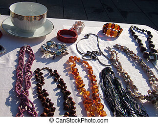 Old stuff - Table with trinkets and glass cup on the street