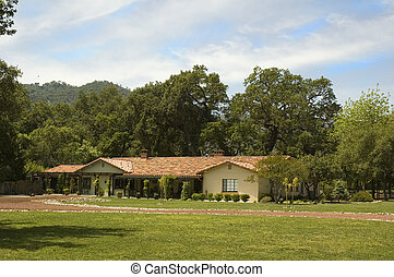 Country ranch style home - spanish tiled Ranch house in the...