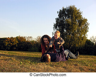 family plays on glade - family plays autumn on sundown on...