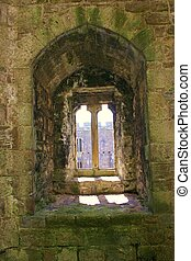 caernarfon castle window looking out over moat