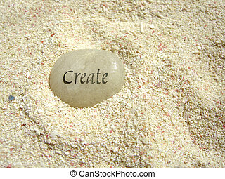 create stone - a create stone in the sand on a beach...