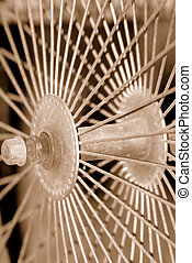 Sepia Spokes - Old antique bicycle spokes in sepia tone. I...