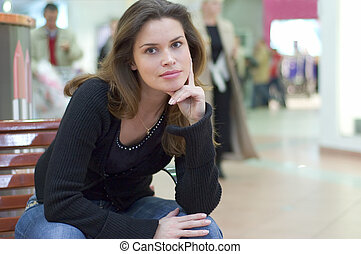 Candid casual portrait in a city mall - Pretty brunette in...