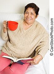 Relaxing at home - Senior asian woman relaxing at home...