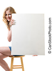 Blank sign - Attractive woman sitting on a stool while...