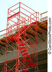 Orange Stairs - Steel orange stairs and scaffolding on a...