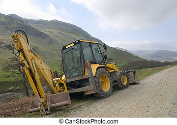 Tractor - A mechanical digger parked in remote highland glen