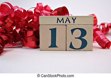 May 13b - Wooden calendar blocks with May 13 and curling red...