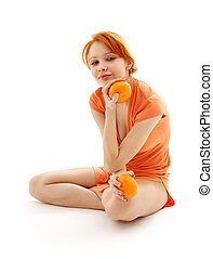cheerful redhead with two oranges