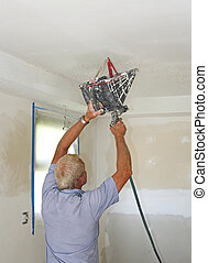 texturing ceilings - Painter spraying texture on ceilings...