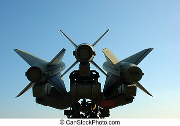 Missiles against blue sky