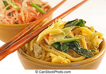 Fried noodles - Fried Thai noodles isolated on a white...