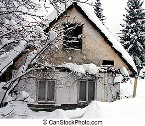 Snow house - Old country house in deep white snow