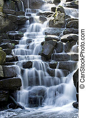 Cascade - Scenic waterfall with white water cascading over...