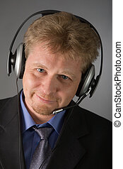 it support - the portrait of man with headphone on grey...