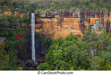 Water fall on a red cliff with vegetation (Australia)