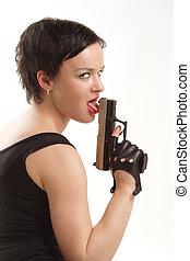 girl licking her gun