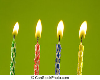 birthday candles - Row on birthday candles against green...