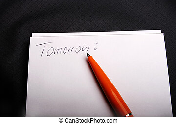 Tomorrow - Digital photo of a notepad with a pencil and the...