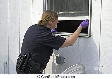Police officer dusting prints - Police woman dusting for...