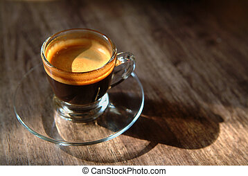 Morning Coffee - A glass cup of crema black coffee on a...
