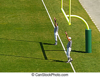 football touchdown referee - referees signaling a touchdown...