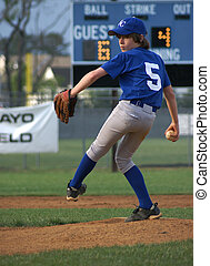 Pitcher Windup 3 - Little league pitcher winding up for the...