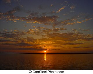molokai sunset - sunset from a lokoia fish pond on island of...