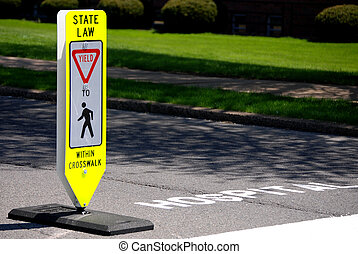 Pedestrian Yield Sign - Traffic sign in middle of street...