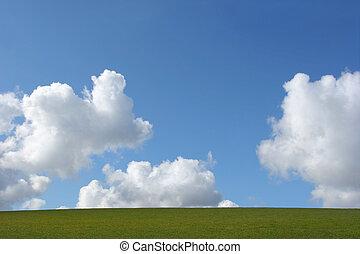 Earth, Clouds and Sky - Cumulus clouds in a blue sky above a...