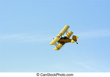 Biplane Crop Duster - A yellow biplane crop duster preparing...