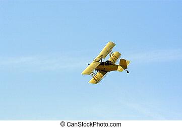 Biplane Crop Duster - A yellow biplane crop duster preparing...