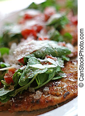 Chicken and Arugula - A dish of a chicken cutlet topped with...